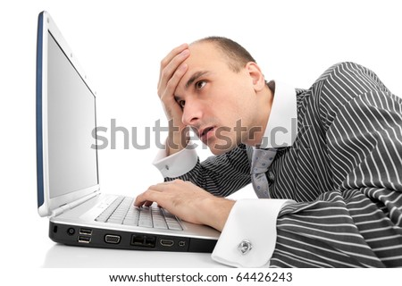 Worried businessman with computer isolated on white - stock photo