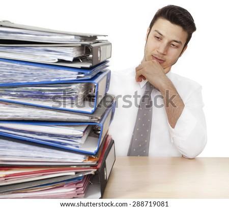 Worried businessman with folders - stock photo