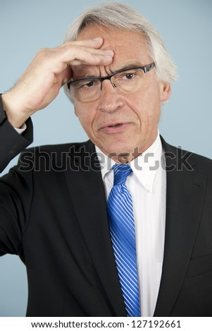 Worried businessman with problem or headache - stock photo