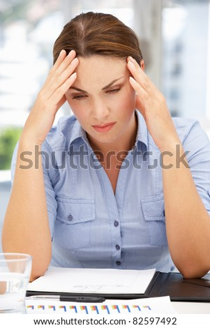Worried businesswoman - stock photo