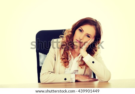 Worried businesswoman at the desk. - stock photo