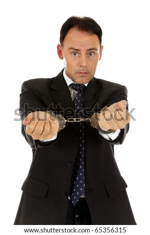 Worried caucasian middle aged businessman in handcuffs . Studio shot. White background - stock photo