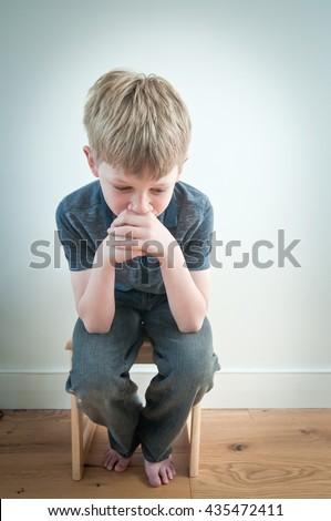 Worried child - stock photo