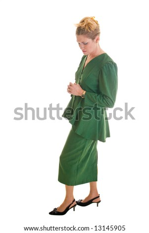 Worried executive business woman holding her hands as in prayer with a troubled expression. - stock photo