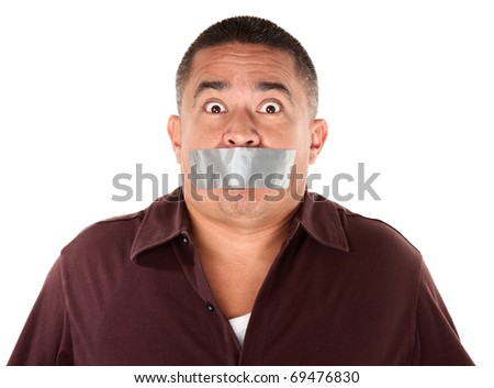Worried Hispanic man with duct tape over his mouth - stock photo