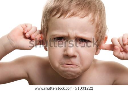 Worried human child boy face hand finger close ear - stock photo