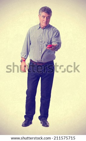Worried man holding a toy car - stock photo