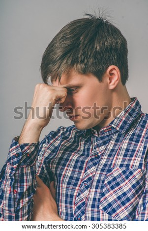 Worried man tries to remember something - stock photo
