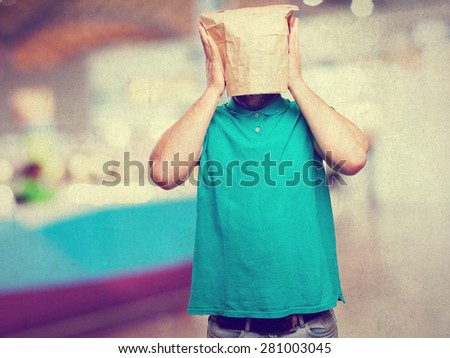 worried man with a paper bag in his head - stock photo