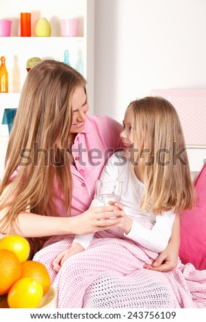 Worried mother with ill child - stock photo
