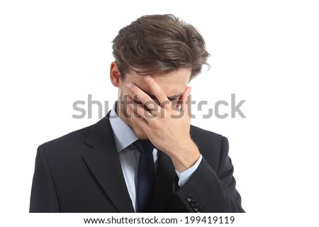 Worried or ashamed man covering his face with hand isolated on a white background - stock photo