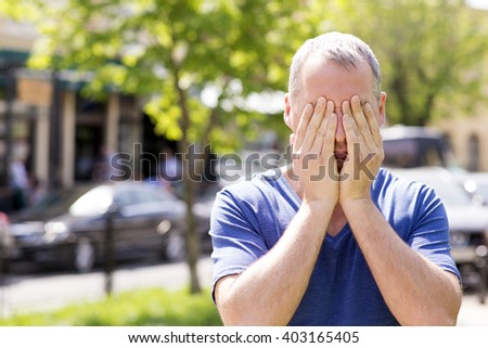 Worried or embarrassed man  - stock photo