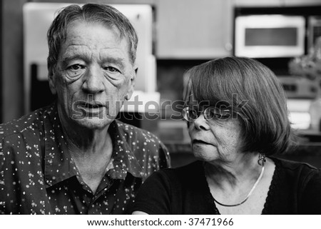 Worried Senior Couple at Home in Modern  Kitchen - stock photo