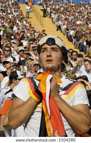 worried soccer supporter praying - stock photo