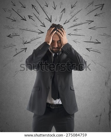 Worried stressed businessman by indecision and problems - stock photo