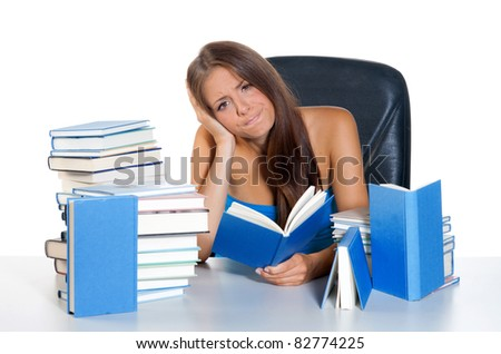 worried woman reading book and thinking - stock photo