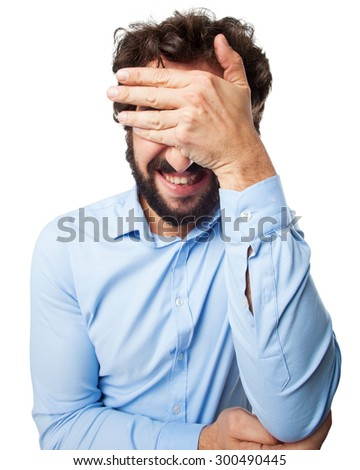 worried young man covering eyes