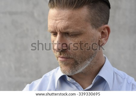 worried young man in blue shirt - stock photo