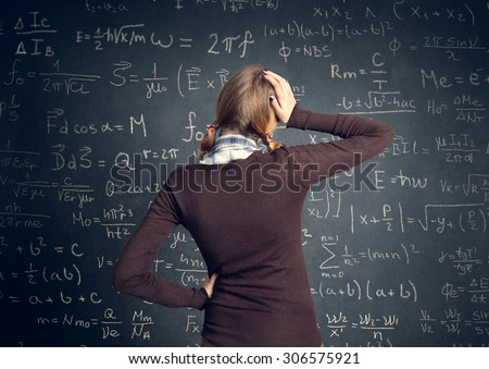 worry student have a problem with mathematics - stock photo