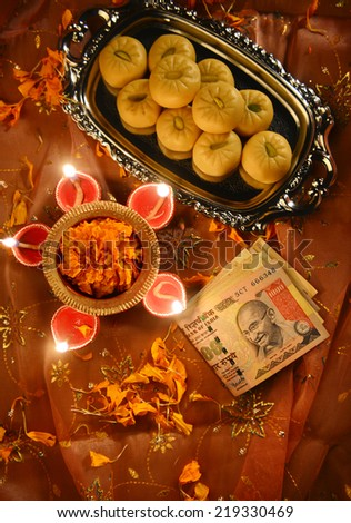 worshiping Indian currency notes as a god of wealth during Diwali Festival - stock photo
