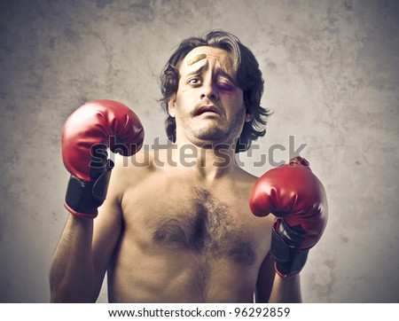 Wounded boxer with tired and frightened expression - stock photo