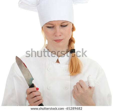 wounded female cook in white uniform and hat - cooking accident with a sharp knife - stock photo