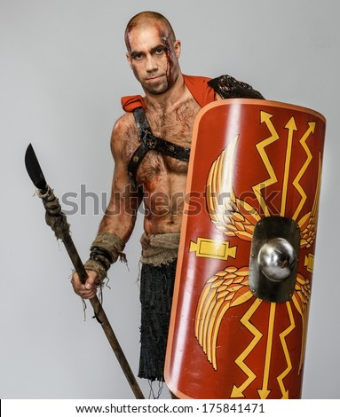 Wounded gladiator with spear and shield  - stock photo