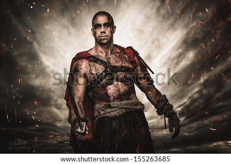 Wounded gladiator  with sword against stormy sky  - stock photo