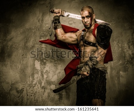 Wounded gladiator with two swords covered in blood