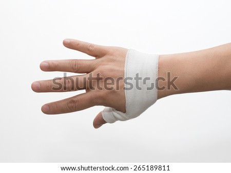 Wounded hand in bandage - stock photo