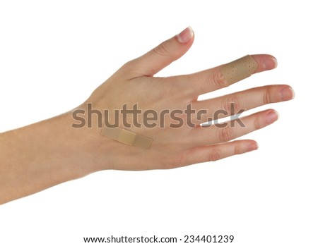 Wounded hand with plaster isolated on white