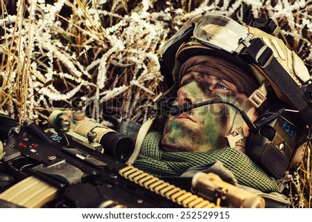 wounded rangers lying on the ground and looking up at the sky - stock photo