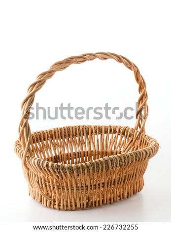 Woven basket on white background - stock photo