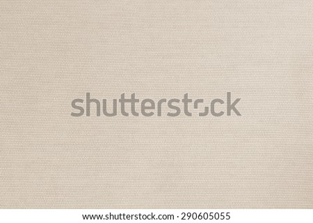 Woven cotton fabrics textile textured background in light cream beige sepia color tone     - stock photo
