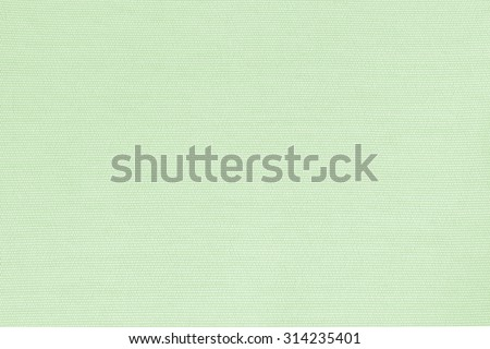 Woven cotton linen fabrics textile textured background in light pale green color tone: Flax satin cloth detail pattern wallpaper backdrop in pale green yellow toned colour   - stock photo