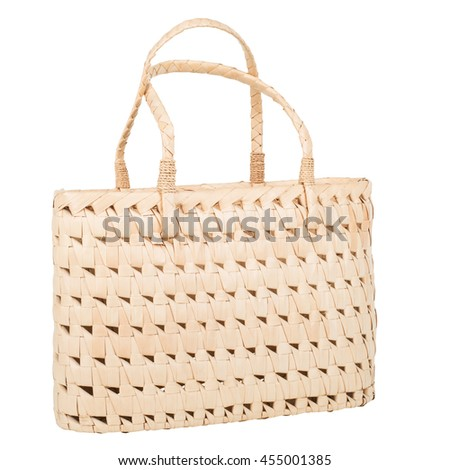 woven handbag with handles made of palm leaves isolate on white background, paths - stock photo