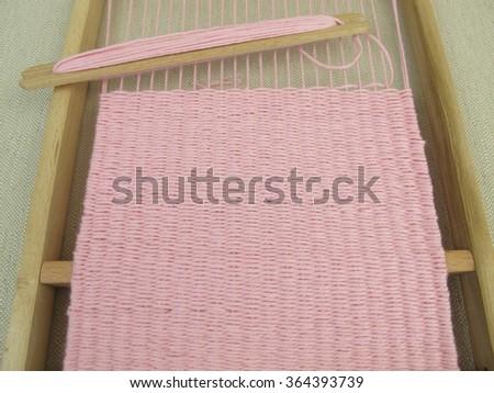 Woven in weaving loom  - stock photo