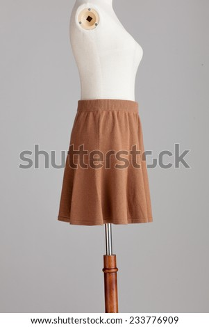 woven woolen brown skirt in model isolated on a grey background - stock photo