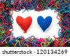 woven woolen hearts on a white fund - stock photo