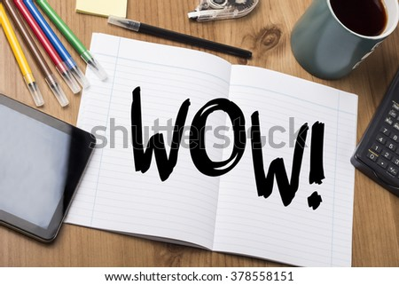 WOW! - Note Pad With Text On Wooden Table - with office  tools - stock photo