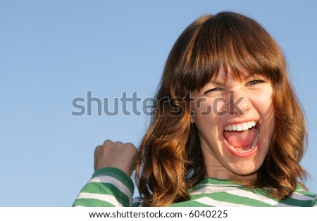Wow! Portrait of emotional teen girl against a blue sky. Shalow DOF, focus on the eyes - stock photo
