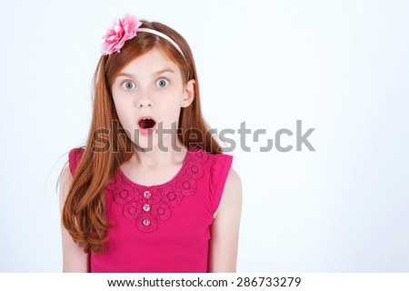 Wow. Pretty young girl holding her hands straight and opening the mouth while expressing surprise. - stock photo