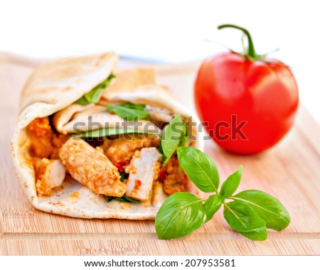 Wrap sandwich Moroccan style with couscous, chicken, tomatoes and basil - stock photo