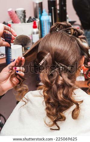 Wrap the hairdresser curling iron, curling irons - stock photo
