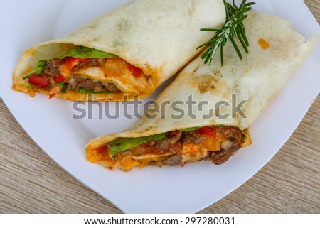 Wrap tortilla with meat, vegetables and spices - stock photo