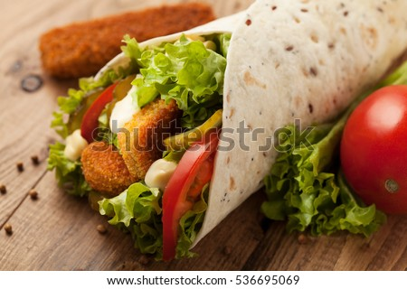 Wrap with chicken on a wood table