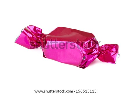 Wrapped candy or sweet on a white background. Clipping path included. - stock photo