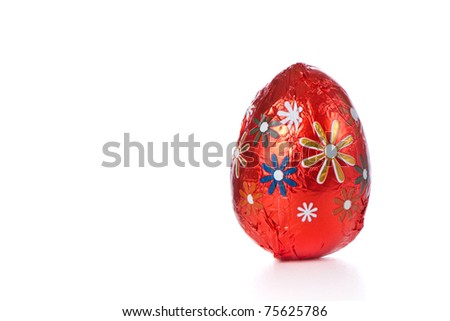 wrapped chocolated easter egg isolated - stock photo