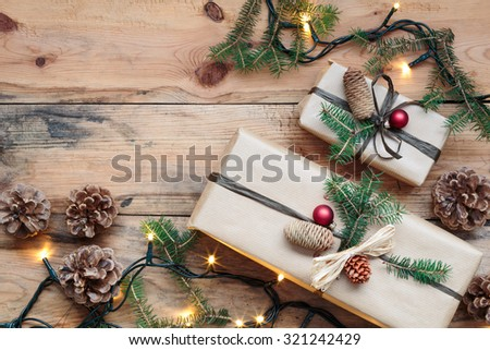 Wrapped Christmas presents on wooden floor - stock photo