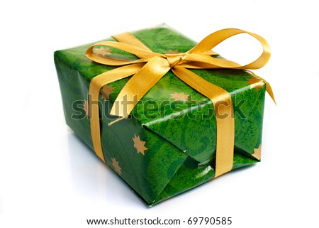 Wrapped gift box with ribbon and bow isolated - stock photo